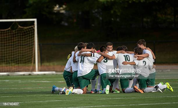 The Walter Johnson team gathers on the field before the game against Churchill at Walter Johnson High School on Tuesday October 15 2013 Churchill...