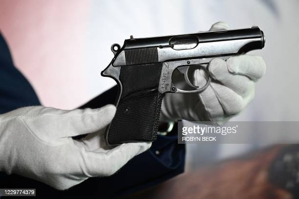 """The Walther PP handgun used by Sean Connery as James Bond in the first James Bond film, """"Dr. No"""" is displayed at a press preview of Julien's Auctions..."""