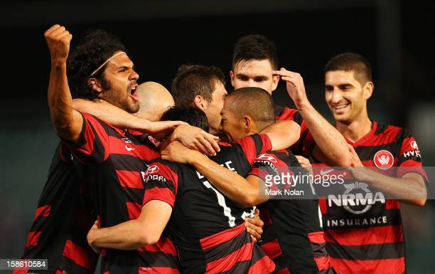 The Wanderers celebrate a goal by Mark Bridge during the round 12 ALeague match between the Western Sydney Wanderers and Adelaide United at...