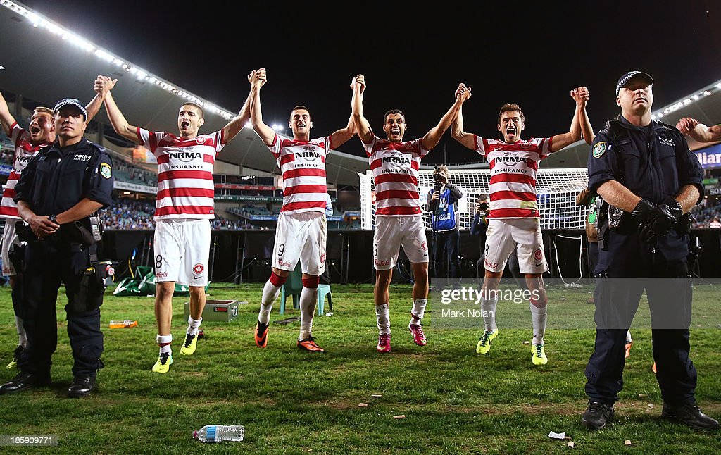 The Wanderers celebrate winning the round three A-League match between Sydney FC and the Western Sydney Wanderers at Allianz Stadium on October 26, 2013 in Sydney, Australia.