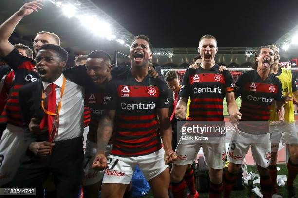 The Wanderers players celebrate with the crowd after victory during the round three A-League match between the Western Sydney Wanderers and Sydney FC...