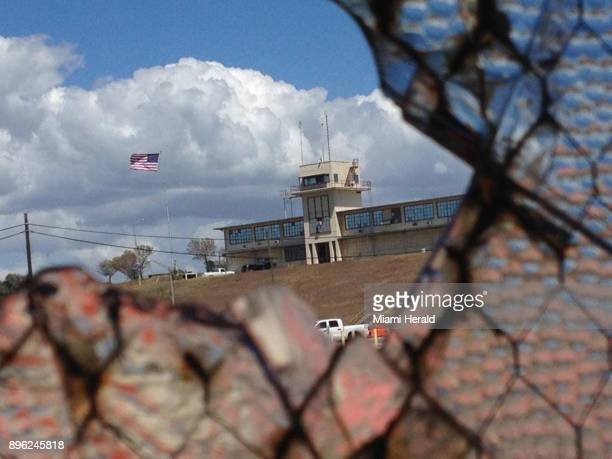 The war court headquarters at Camp Justice as seen through a broken window at an obsolete air hangar at the US Navy base at Guantanamo Bay Cuba on...