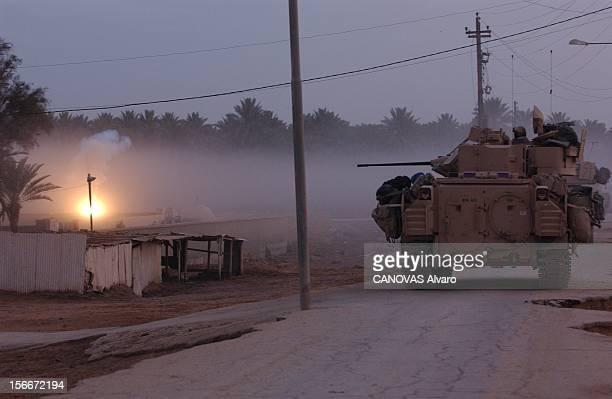 The War In Iraq With Scouts Of 41th Regiment Infantry La bataille de ASSAMAWAH de nuit char dans une rue de la ville
