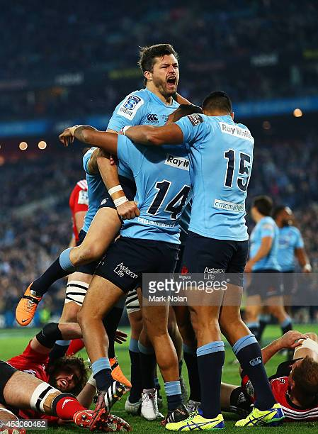 The Waratahs celebrate a try by Adam AshleyCooper during the Super Rugby Grand Final match between the Waratahs and the Crusaders at ANZ Stadium on...