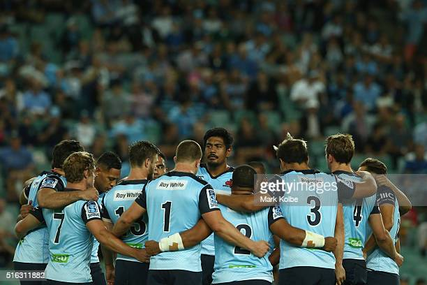 The Waratahs team form a huddle as they pause for a moment silence in rememberance for former Fiji and Highlanders rugby player Seru Rabeni during...