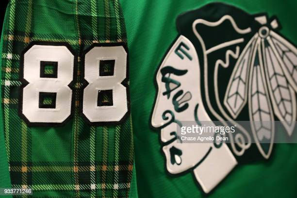 The warmup jersey of Patrick Kane of the Chicago Blackhawks is green to celebrate St Patricks Day prior to the game against the St Louis Blues at the...