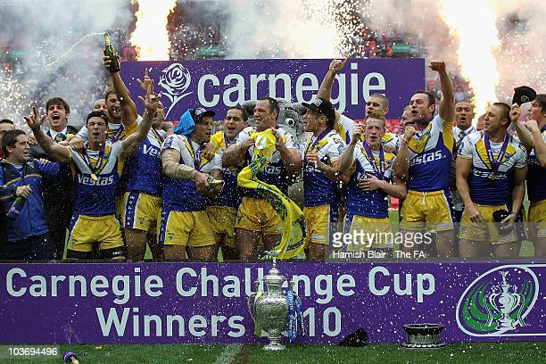 The Warrington team celebrate with the trophy after the Challenge Cup Final between Leeds Rhinos and Warrington Wolves at Wembley Stadium on August...