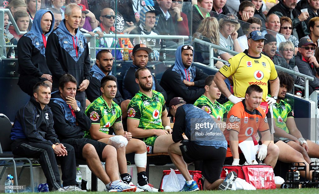 The Warriors bench featuring coach Matthew Elliott, Shaun Johnson and Simon Mannering during the NRL trial match between the Brisbane Broncos and the New Zealand Warriors at Forsyth Barr Stadium on February 23, 2014 in Dunedin, New Zealand.