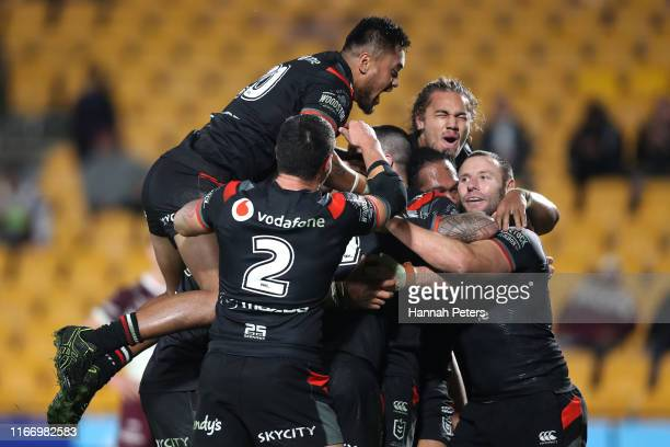 The Warriors celebrate after Jazz Tevaga of the Warriors scored a try during the round 21 NRL match between the New Zealand Warriors and the Manly...