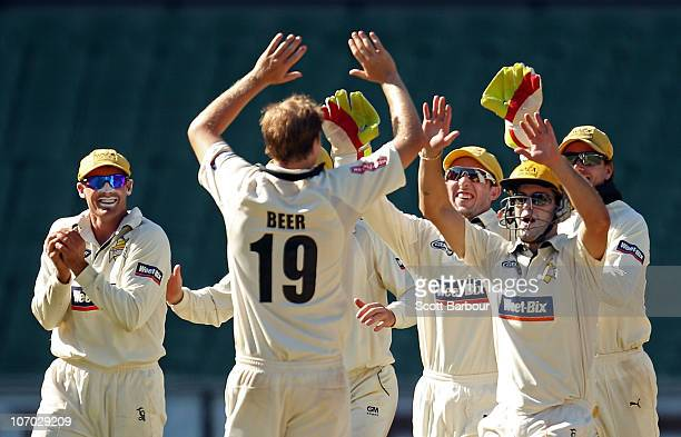 The Warriors celebrate claiming the last wicket to win the match during day four of the Sheffield Shield match between the Victorian Bushrangers and...