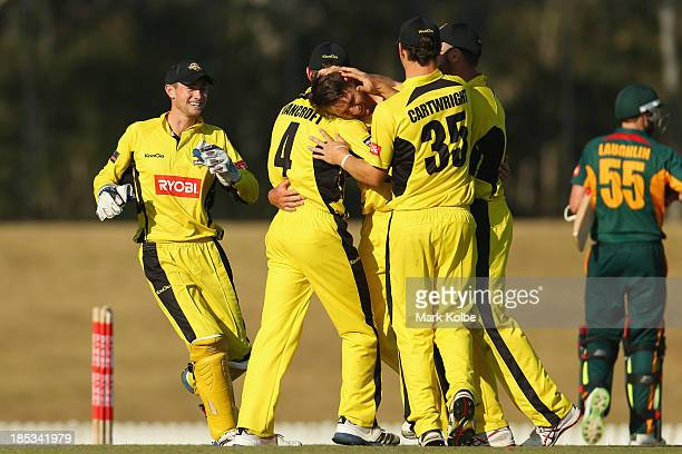 The Warriors celebrate victory after Andrew Tye of the Warriors took the final wicket of Ben Laughlin of the Tigers during the Ryobi Cup match...