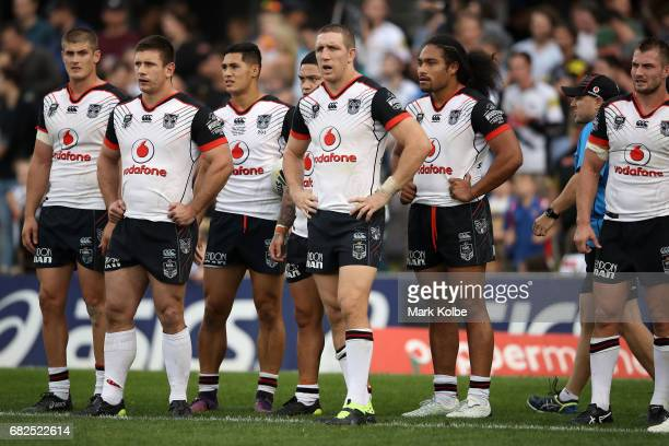 The Warriors players look dejected after a Panthers try during the round 10 NRL match between the Penrith Panthers and the New Zealand Warriors at...