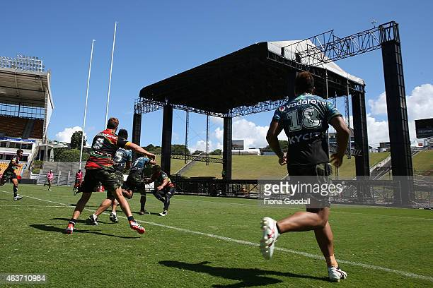 The Warriors train as the stage is constructed for the Foo Fighters concert on Saturday during a New Zealand Warriors NRL training session at Mt...