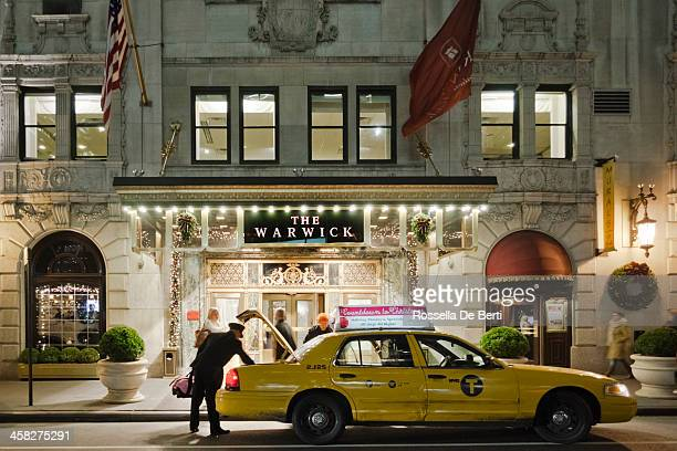 the warwick hotel, new york - doorman stock photos and pictures