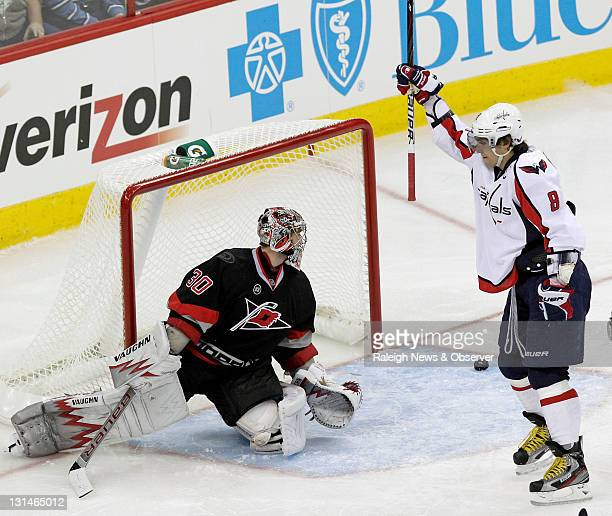 The Washington Capitals' Alex Ovechkin celebrates after his teammate John Carlson not pictured scored against the Carolina Hurricanes' Cam Ward...