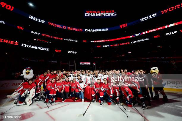 The Washington Capitals and Washington Nationals pose for a photo after the Nationals were honored during a pregame ceremony to celebrate the...