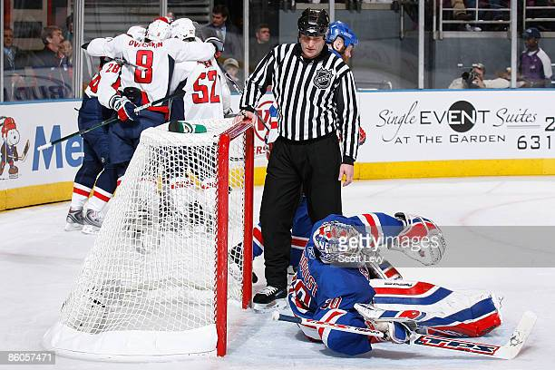 The Washington Capitals celebrate a secondperiod goal by Brooks Laich against goaltender Henrik Lundqvist of the New York Rangers during Game Three...
