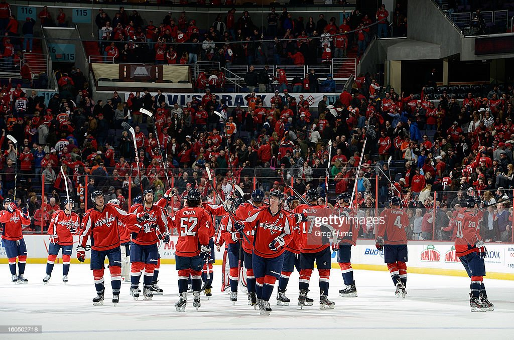 The Washington Capitals celebrate after a 3-2 victory against the Philadelphia Flyers at the Verizon Center on February 1, 2013 in Washington, DC.