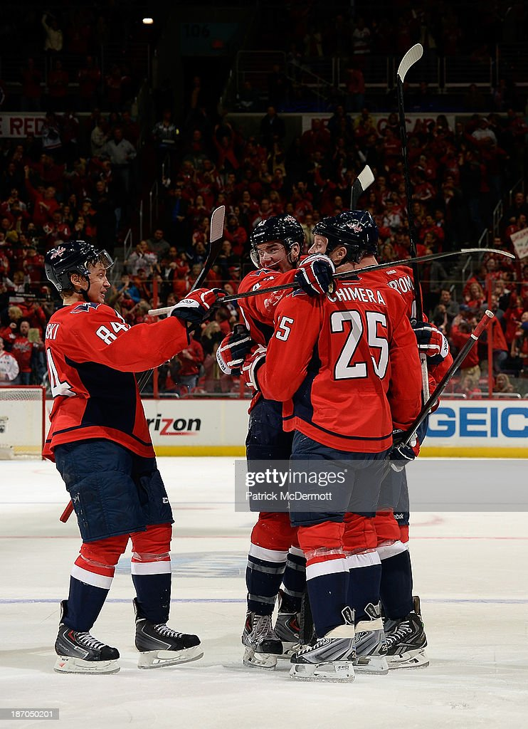 The Washington Capitals celebrate after Alexander Urbom #34 scored a goal in the second period of an NHL game against the New York Islanders at Verizon Center on November 5, 2013 in Washington, DC.