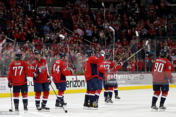 The Washington Capitals celebrate after defeating the Columbus Blue Jackets at Verizon Center on March 28 2016 in Washington DC