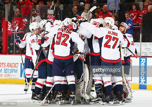 The Washington Capitals celebrate after defeating the New Jersey Devils in a shootout at the Prudential Center on February 6 2016 in Newark New...