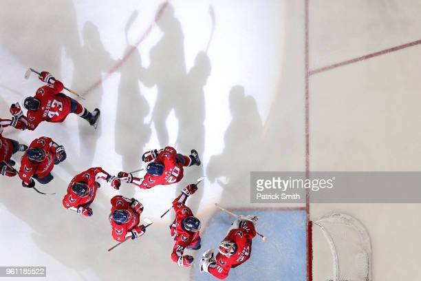 The Washington Capitals celebrate after defeating the Tampa Bay Lightning in Game Six of the Eastern Conference Finals during the 2018 NHL Stanley...