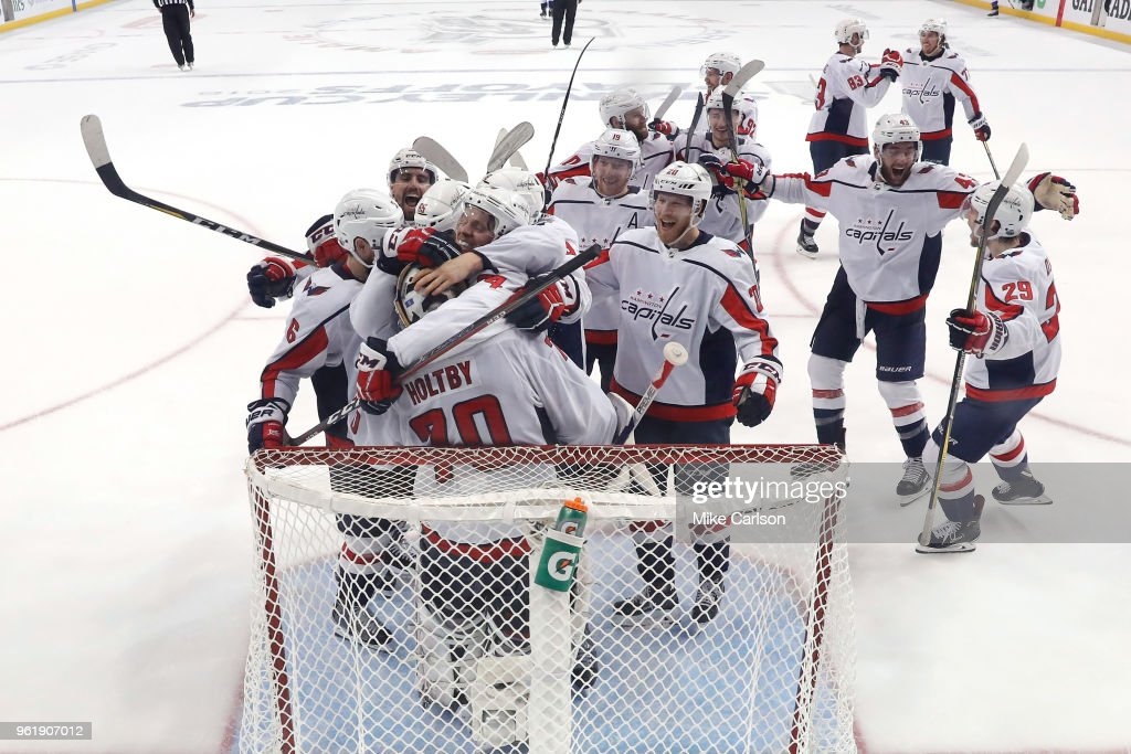 The Washington Capitals celebrate after defeating the Tampa Bay Lightning in Game Seven of the Eastern Conference Finals during the 2018 NHL Stanley Cup Playoffs at Amalie Arena on May 23, 2018 in Tampa, Florida. The Washington Capitals defeated the Tampa Bay Lightning with a score of 4 to 0.