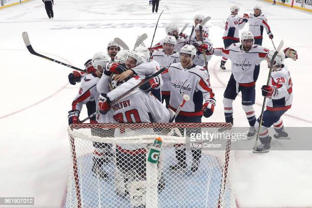 The Washington Capitals celebrate after defeating the Tampa Bay Lightning in Game Seven of the Eastern Conference Finals during the 2018 NHL Stanley...