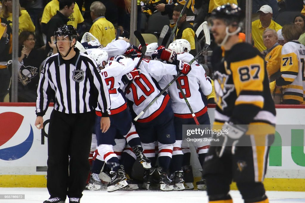 The Washington Capitals celebrate moving on to the Eastern Conference Finals after a 2-1 overtime win behind Sidney Crosby #87 of the Pittsburgh Penguins in Game Six of the Eastern Conference Second Round during the 2018 NHL Stanley Cup Playoffs at PPG Paints Arena on May 7, 2018 in Pittsburgh, Pennsylvania.