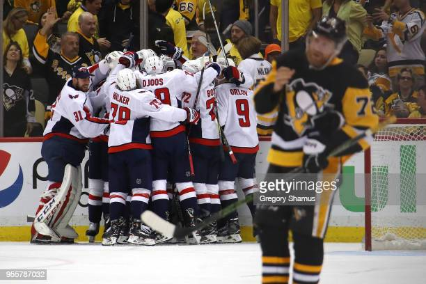 The Washington Capitals celebrate moving on to the Eastern Conference Finals after a 21 overtime win behind Patric Hornqvist of the Pittsburgh...