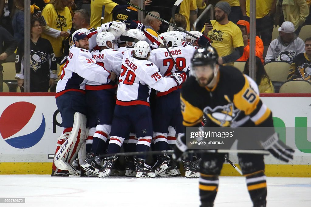 The Washington Capitals celebrate moving on to the Eastern Conference Finals after a 2-1 overtime win behind Kris Letang #58 of the Pittsburgh Penguins in Game Six of the Eastern Conference Second Round during the 2018 NHL Stanley Cup Playoffs at PPG Paints Arena on May 7, 2018 in Pittsburgh, Pennsylvania.