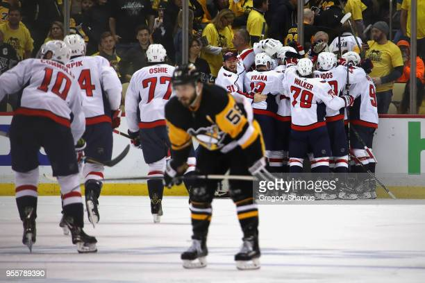 The Washington Capitals celebrate moving on to the Eastern Conference Finals after a 2-1 overtime win behind Kris Letang of the Pittsburgh Penguins...