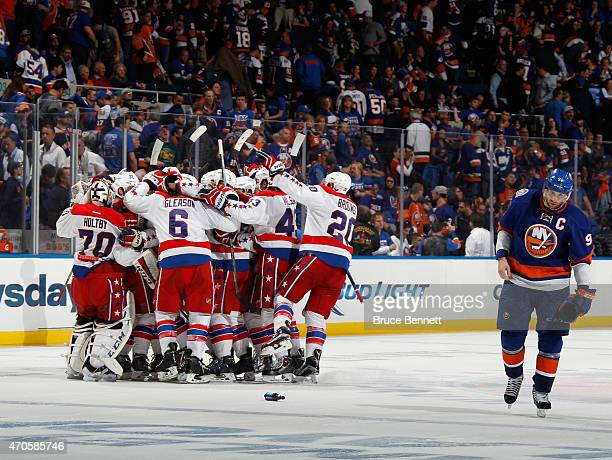 The Washington Capitals celebrate the game winning overtime goal at 1109 of the first overtime period by Nicklas Backstrom against the New York...