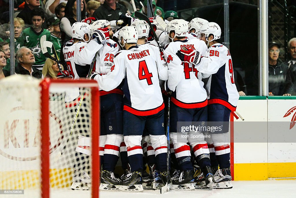 The Washington Capitals celebrate winning in overtime during the game between the Dallas Stars and the Washington Capitals on January 21, 2017 at the American Airlines Center in Dallas, Texas. Washington defeats Dallas in overtime 4-3.