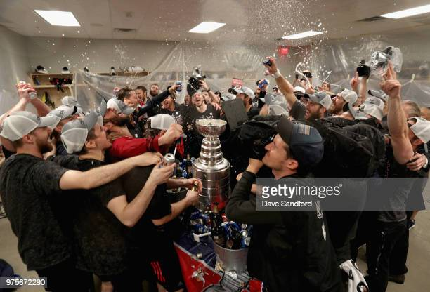 The Washington Capitals celebrate winning the Stanley Cup in the locker room after they defeated the Vegas Golden Knights 43 in Game Five of the 2018...
