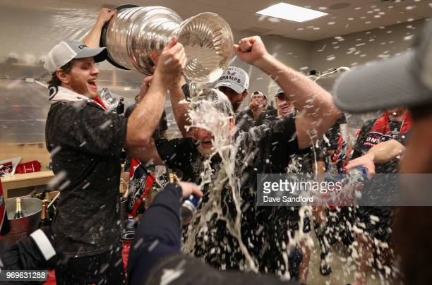 The Washington Capitals celebrates winning the Stanley Cup in the locker room after the Capitals defeated the Vegas Golden Knights 43 in Game Five of...