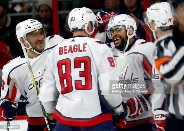 The Washington Capitals' Devante SmithPelly celebrates his goal with teammates Alex Ovechkin Jay Beagle and John Carlson during the first period...