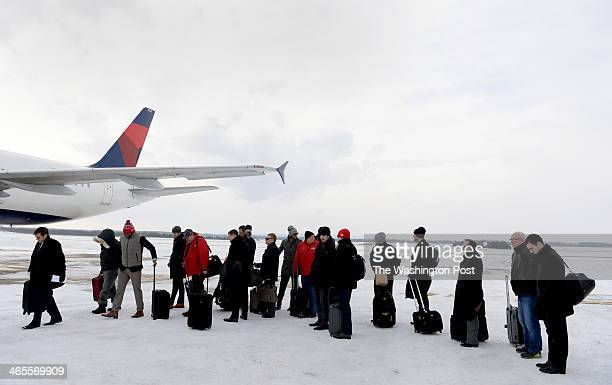 The Washington Capitals during the annual trip where dads brothers and friends come along on a road trip waits on a windswept frozen tarmac at Dulles...