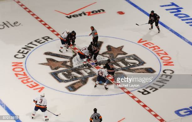 The Washington Capitals face off against the New York Islanders during the first game after the arena's name changed to Verizon Center from MCI...