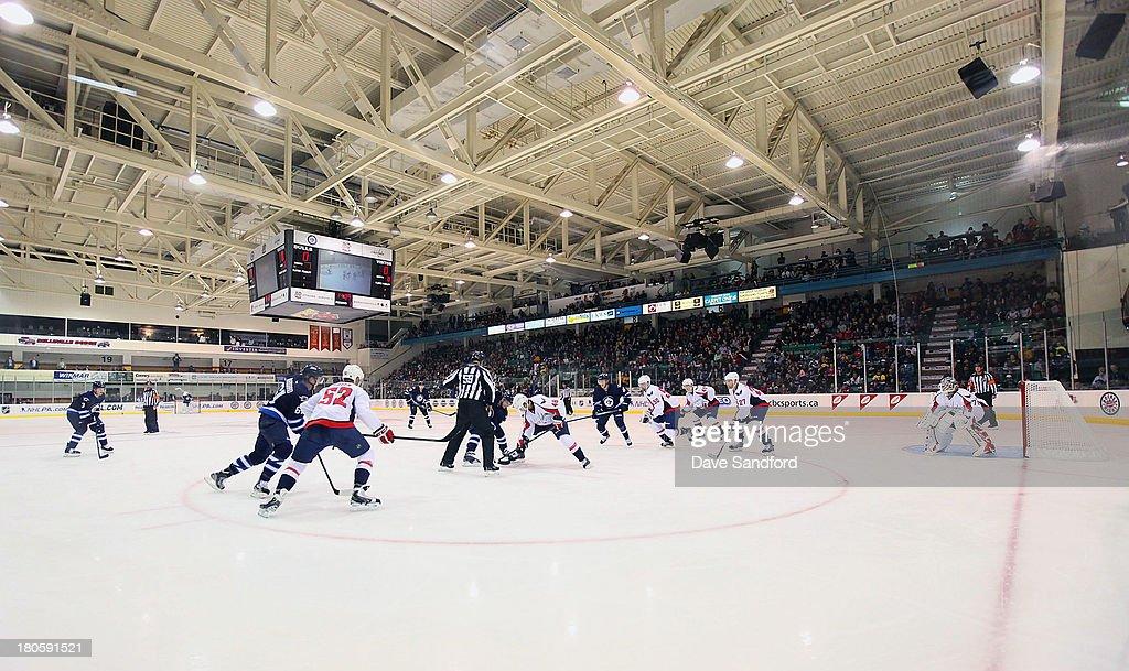 The Washington Capitals face the Winnipeg Jets during Kraft Hockeyville Day 2 at Yardmen Arena on September 14, 2013 in Belleville, Ontario, Canada.