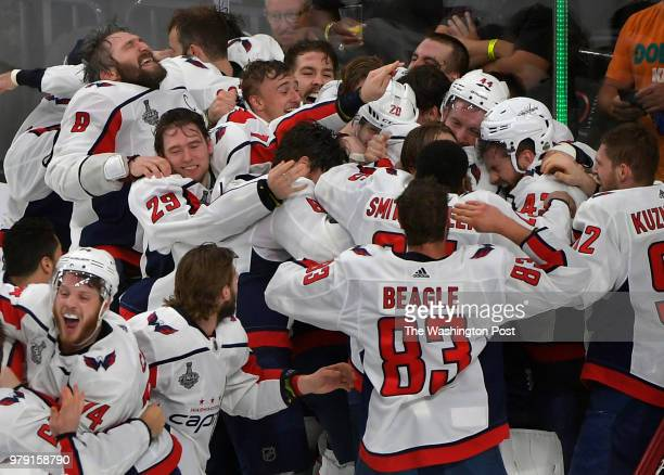 The Washington Capitals mob Washington goaltender Braden Holtby at the end of the game in celebrating winning the Stanley Cup during the second...