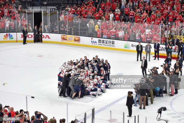 The Washington Capitals pose for a photo with the Stanley Cup after defeating the Vegas Golden Knights in Game Five of the Stanley Cup Final during...