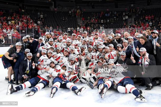 The Washington Capitals pose for a photo with the Stanley Cup after their team's 43 win over the Vegas Golden Knights in Game Five of the 2018 NHL...