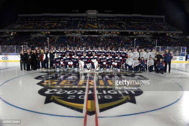 The Washington Capitals pose for a team photo at center ice prior to the 2018 Coors Light NHL Stadium Series game between the Toronto Maple Leafs and...