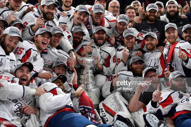 The Washington Capitals pose for a team photo with the Stanley Cup after defeating the Vegas Golden Knights in Game Five of the Stanley Cup Final...