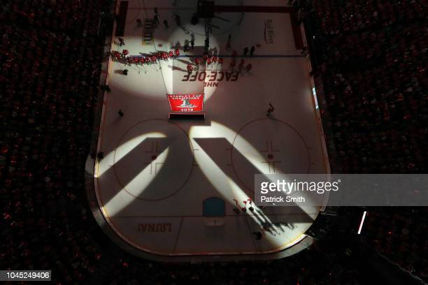The Washington Capitals watch their 2018 Stanley Cup Championship banner rise to the rafters before playing against the Boston Bruins at Capital One...