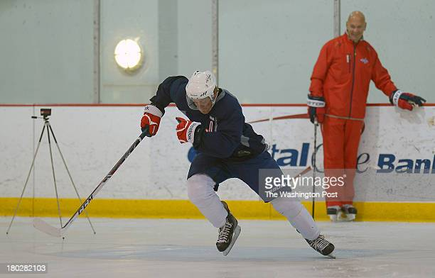 the Washington Captials Nate Schmidt left takes off on sprint drills under the eye of Steve Richmond director of player development during a rookie...