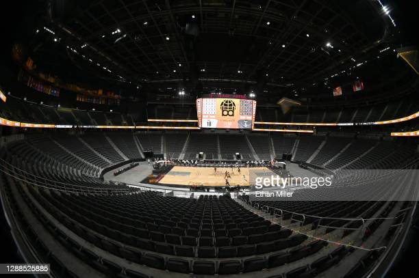 The Washington Huskies and the Baylor Bears play in the first half of their game during the #VegasBubble basketball tournament at T-Mobile Arena on...