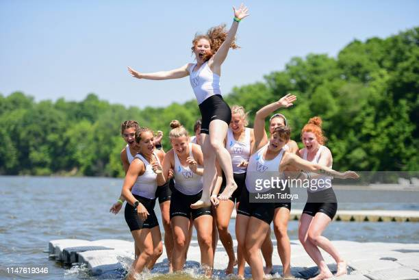 The Washington Huskies celebrate winning the Division I Women's Rowing Championship held at the Indianapolis Rowing Center on June 2, 2019 in...
