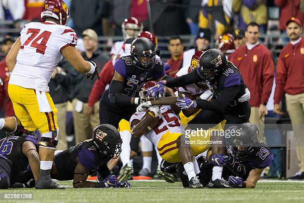 The Washington Huskies defense gang tackles USC tailback Ronald Jones during an NCAA football game between the USC Trojans and the Washington Huskies...